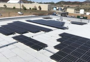 Commercial Solar installation on the roof of Flagstaff Collision Center