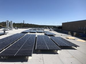 Commercial rooftop solar installation at Flagstaff Collision Center Arizona