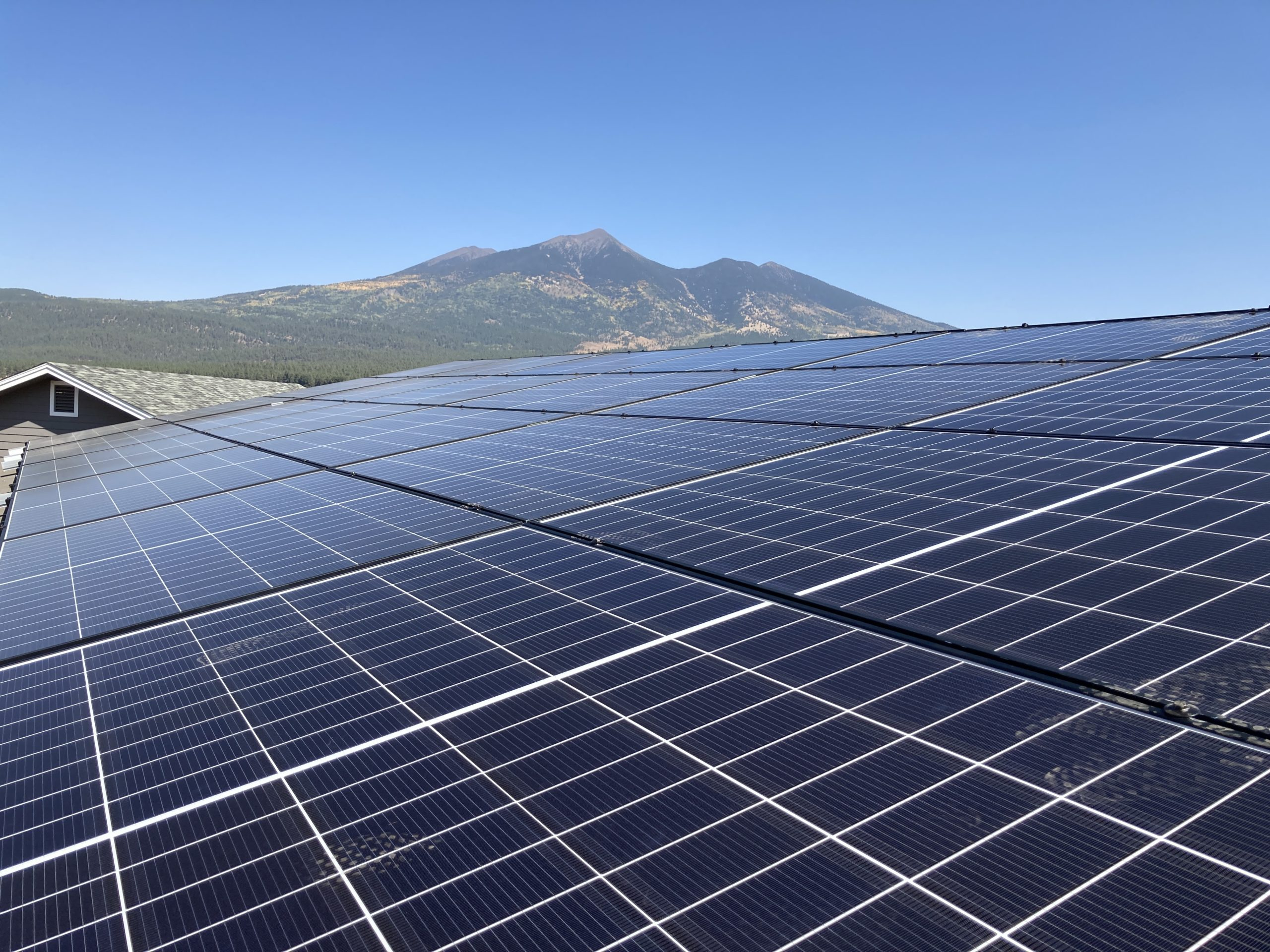 Solar Panels with Peaks in background